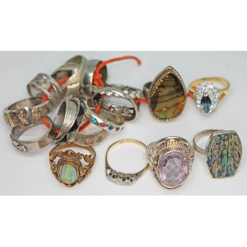 201 - A mixed lot of gold, silver, yellow and white metal rings including one set with an oval mixed cut a...