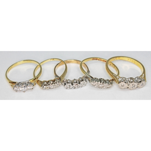 202 - A group of five gold and diamond set rings comprising two hallmarked 18ct gold, two marked '18ct' an...