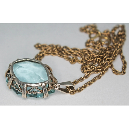 203 - An Art Deco marquis mixed cut aquamarine pendant set in open work white metal unmarked and hung on 9...