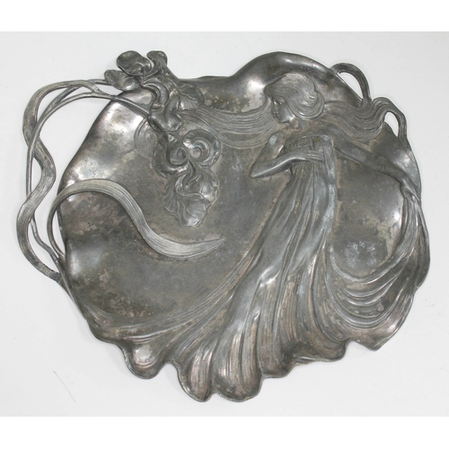1 - An Art Nouveau decorative pewter tray depicting a girl with long hair, the handle formed from stylis...