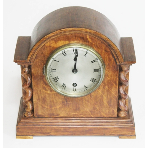 11 - An oak mantle clock with steel dial, height 23.5cm....