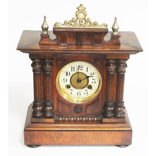 12 - A late 19th century walnut mantle clock, height 39cm....