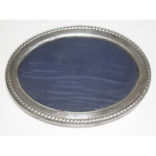 27 - A hallmarked silver photograph frame, length 16.5cm....
