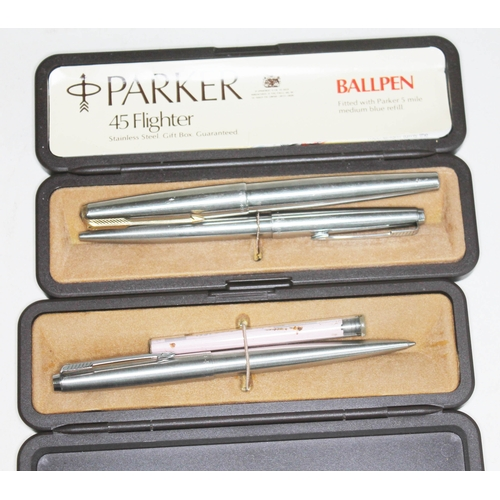 31 - A group of three Parker pens comprising two ballpoints and a fountain pen....