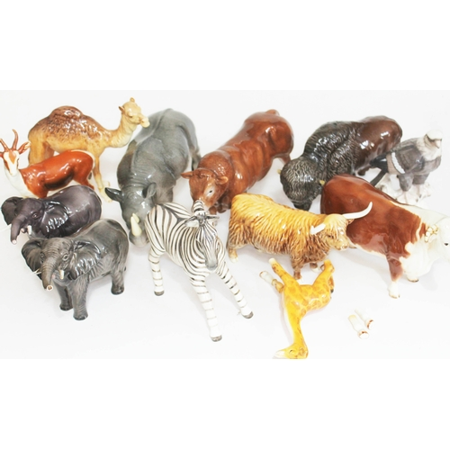 46 - A group of 10 Beswick animals comprising two bulls, a highland cow, two elephants, a byson, a camel,...