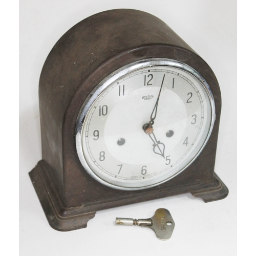 7 - An early 20th century Smiths domed top bakelite mantle clock with silvered dial and Smiths key, heig...