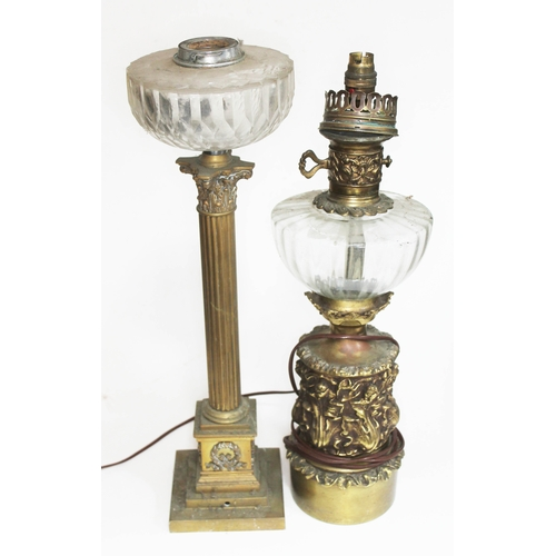 17 - Two oil lamps, heights 52cm & 54cm. (Converted)...