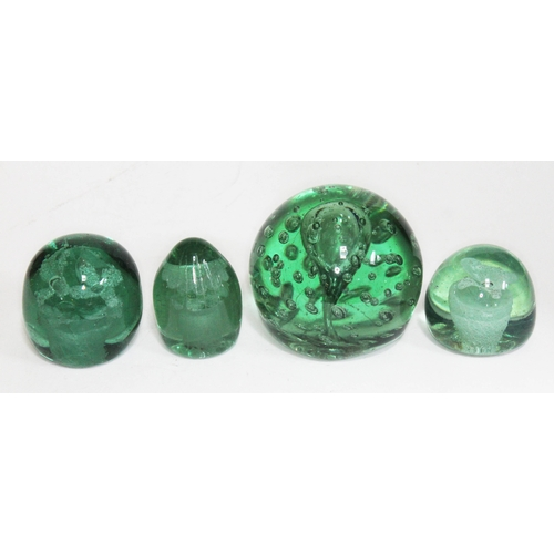 2 - A group of four Victorian green glass dumps, 7.5cm - 10cm....