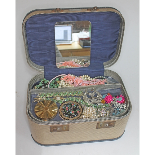22 - A vintage vanity case with various costume jewellery including a Scottish silver brooch and a Scotti...