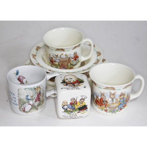24 - Four pieces of Royal Doulton Bunnykins together with a Wedgwood Jemima Puddleduck mug and a nursery ...