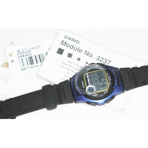 32 - A Casio 3237 digital wristwatch with rubber strap and original user manual....
