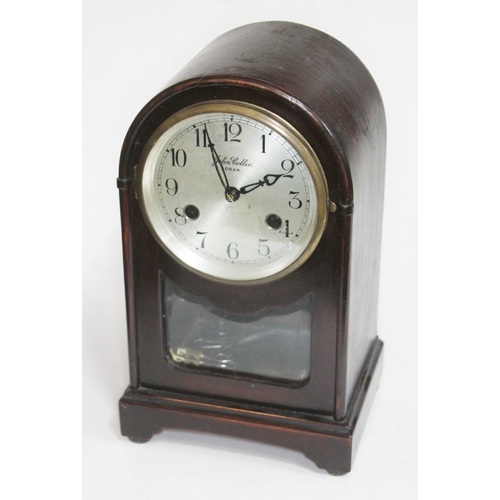 5 - An early 20th century domed top mantle clock, the silver dial signed 'John Collie Oban', height 29cm...