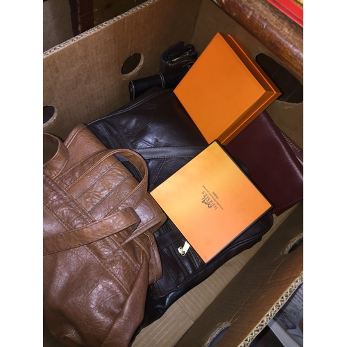112 - A box of handbags, purses, Hermes belts, some leather...