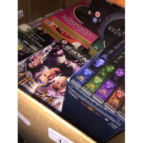 114 - A box with various collections of DVDs related to Star Trek, Farscape, Stargate SG1, etc....