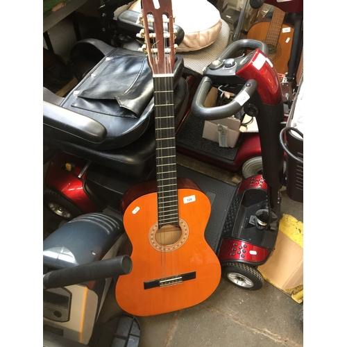 128 - A Hohner MC-05 acoustic guitar...