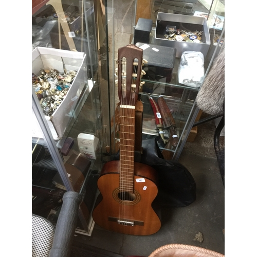 131 - An Angelica acoustic guitar....