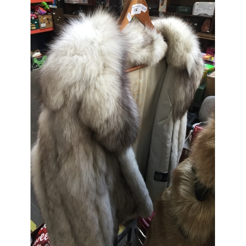 134 - A silver fox fur jacket, with pockets, good condition overall....