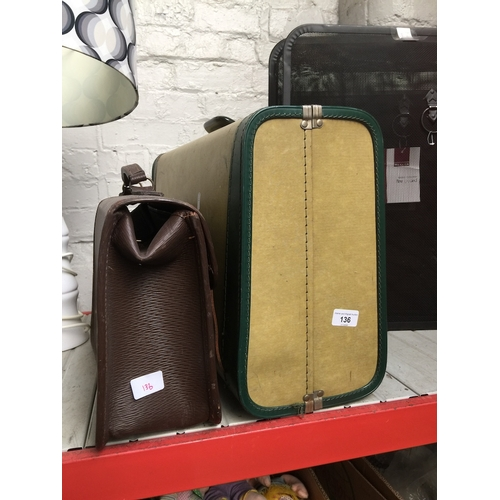 136 - A hard shell suitcase and another case....