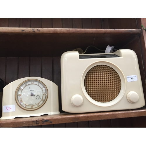 37 - A Bush cream bakelite vintage radio and a vintage cream bakelite Smiths 30 hours clock....