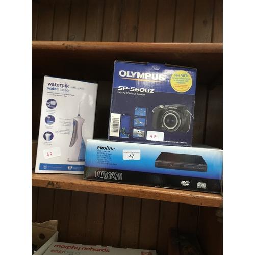 47 - ProLine DVD player, Olympus SP-560 UZ digital compact camera and Waterpik waterflosser....