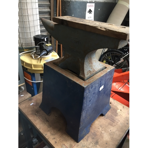 5 - A 51 kg anvil on stand....