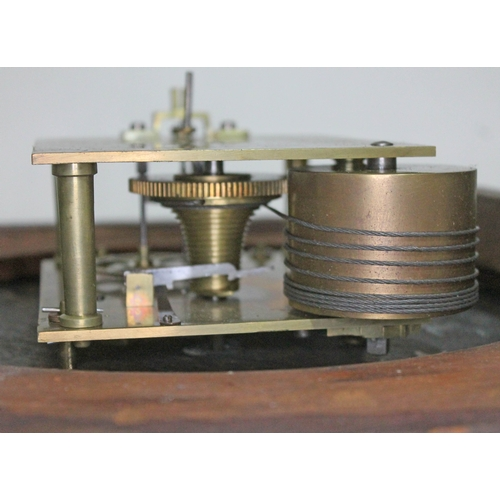 27 - A single fusee wire driven round wall clock, total diam. 36.5cm....