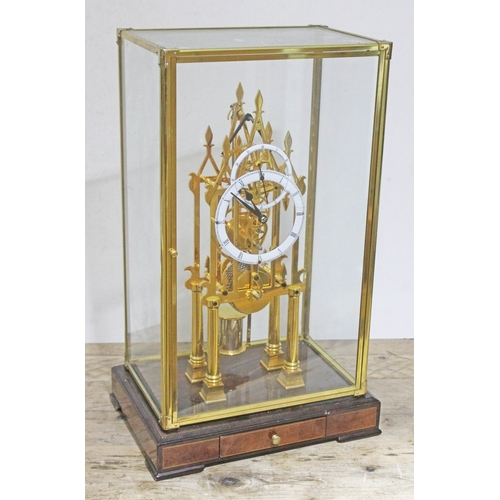 29 - A brass single fusee chain driven skeleton clock under glass case, height 56cm....