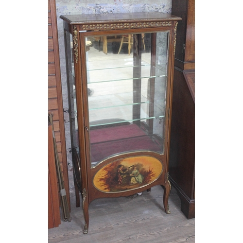 37 - A French glazed display cabinet with gilt metal mounts, lower painted romantic scene on oval panel w...