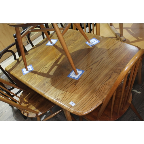 40 - An Ercol blonde elm drop leaf table and four spindle back chairs, max length 138cm, width 74cm....