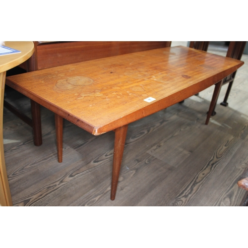 44 - A Gordon Russell teak long coffee table on tapered legs, height 40cm length 121cm....