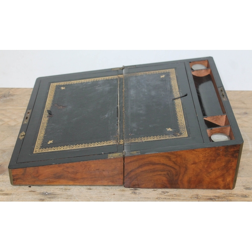 46 - A 19th century walnut writing box with brass inlaid canted corners, tooled black leather writing sur...