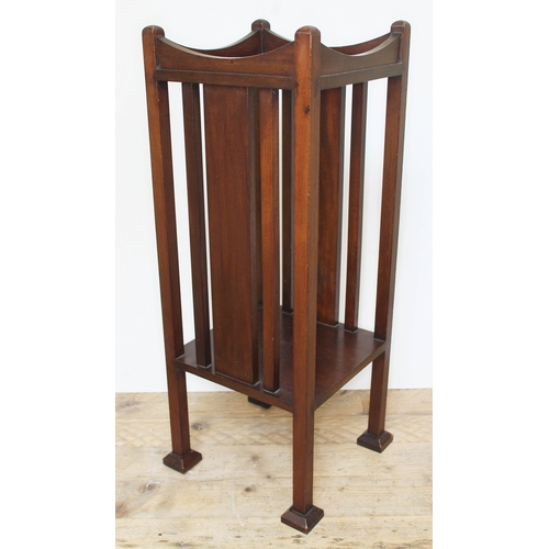 47 - An Edwardian Arts & Crafts style mahogany plant stand with slatted sides, lower tier, on squared fee...