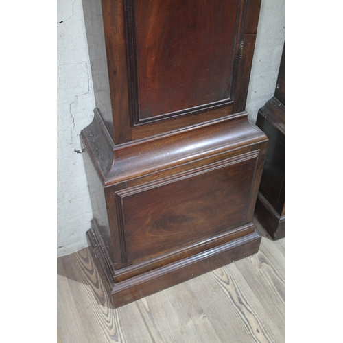21 - A George III eight day mahogany long case clock, domed top with fret work and arched hood with brass...