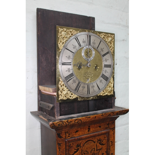 25 - A William & Mary/Queen Anne eight day long case clock, arabesque marquetry inlaid case, the hood wit...