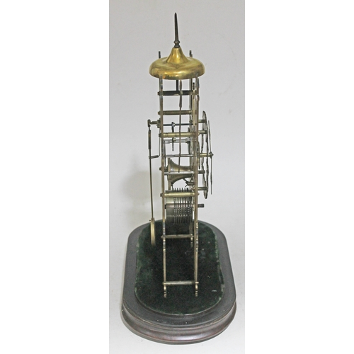 28 - A Gothic style single fusee chain driven brass skeleton clock under a glass dome, height 52cm....