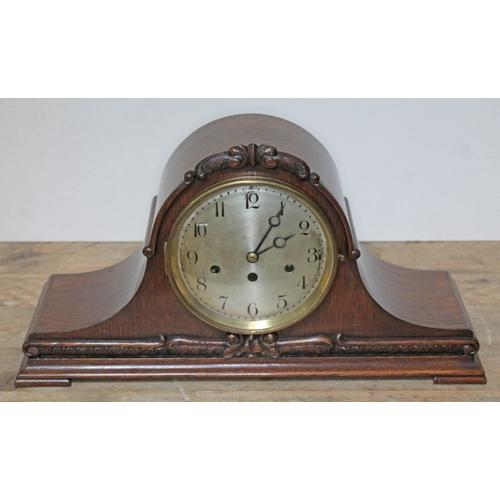 33 - A Junghans steel dial West Minster chime mantle clock in carved oak case, length 53cm, height 28cm....