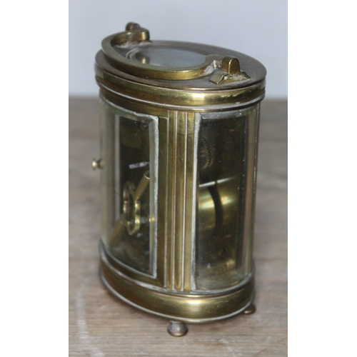 35 - A late 19th century French brass carriage clock of oval form, 12.5cm....