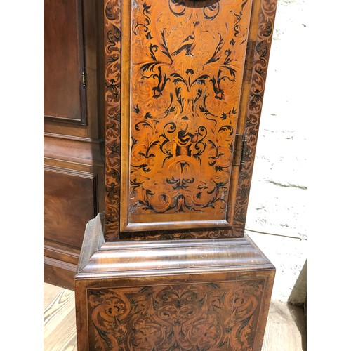 22 - A William & Mary/Queen Anne eight day long case clock with arabesque marquetry inlaid case, hood wit...