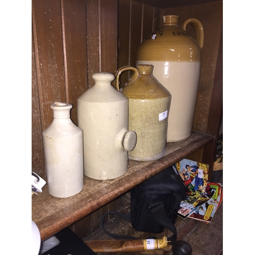 31 - 2 stoneware flagons, a stoneware bed warming bottle and a stoneware bottle....