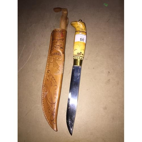 35 - A Norwegian hunting knife in leather sheath...