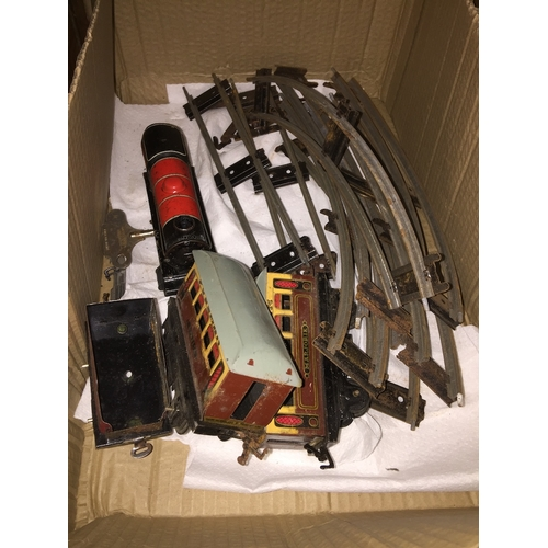 58 - A Hornby o gauge tinplate toy trainset...