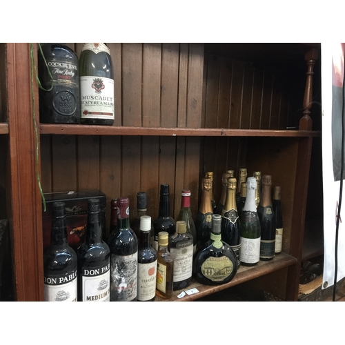 1 - A quantity of mixed alcoholic drinks including wines, champagne, whisky, rum and a bottle of Chateau...