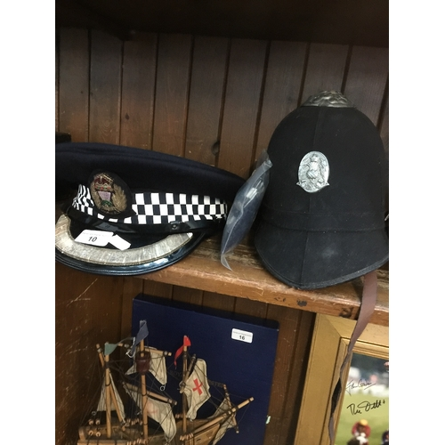 10 - Two vintage police hats...