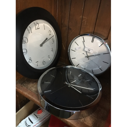 13 - Three quartz wall clocks...