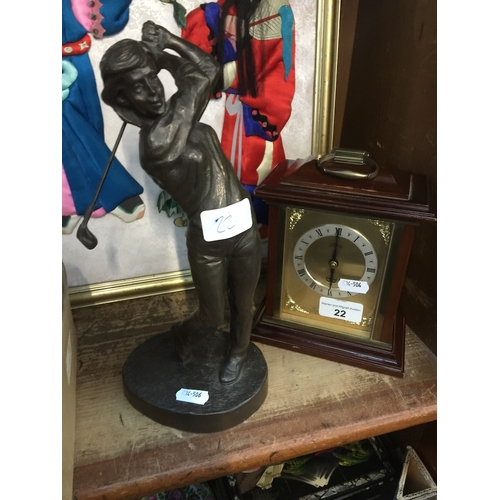22 - A bronzed golfing figure and a mantle clock...