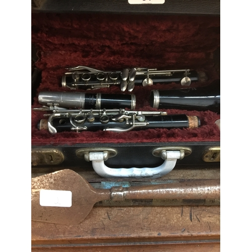 31 - A cased Besson Embassy clarinet....
