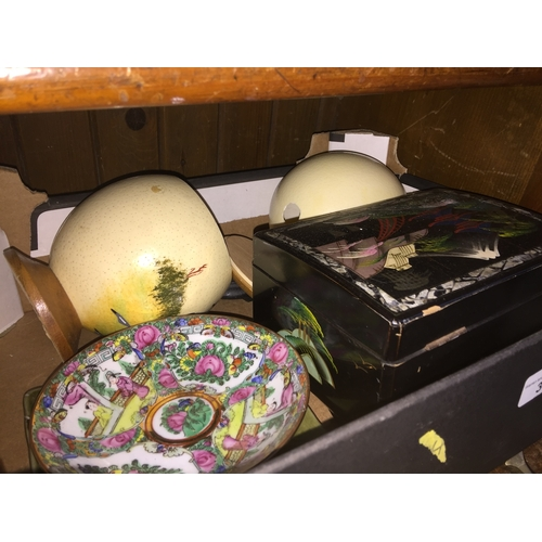 39 - A box containing Ostrich eggs and Oriental items...