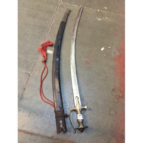 40 - A 19th century curved and single edged blade sword...