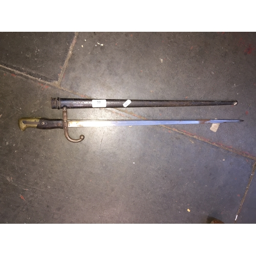 46 - An antique French bayonet and scabbard...
