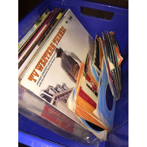 54 - A crate of LPs and singles...